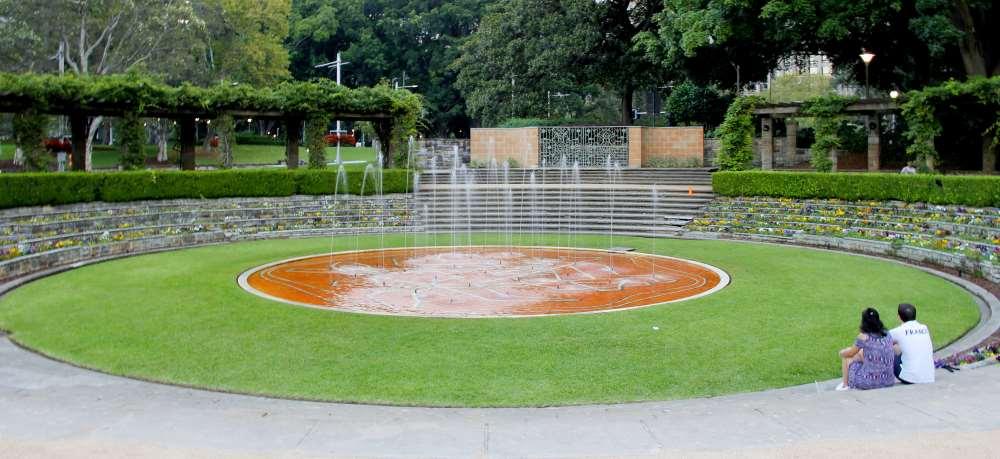 A couple enjoying the solitude of the Sandringham Garden fountains